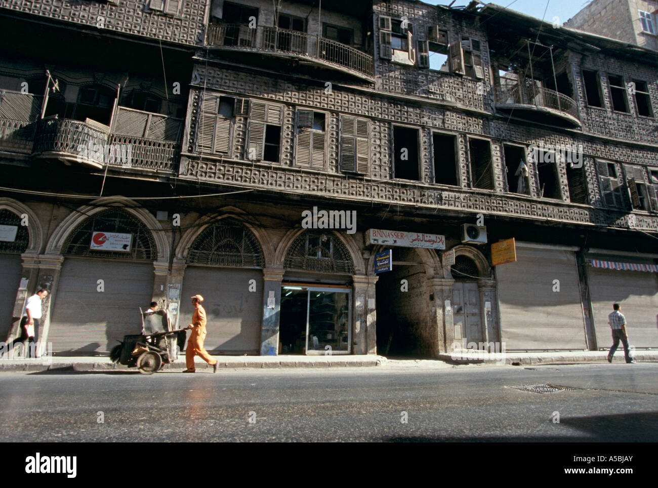 Residential building with shophouses below, Aleppo, Syria Stock Photo