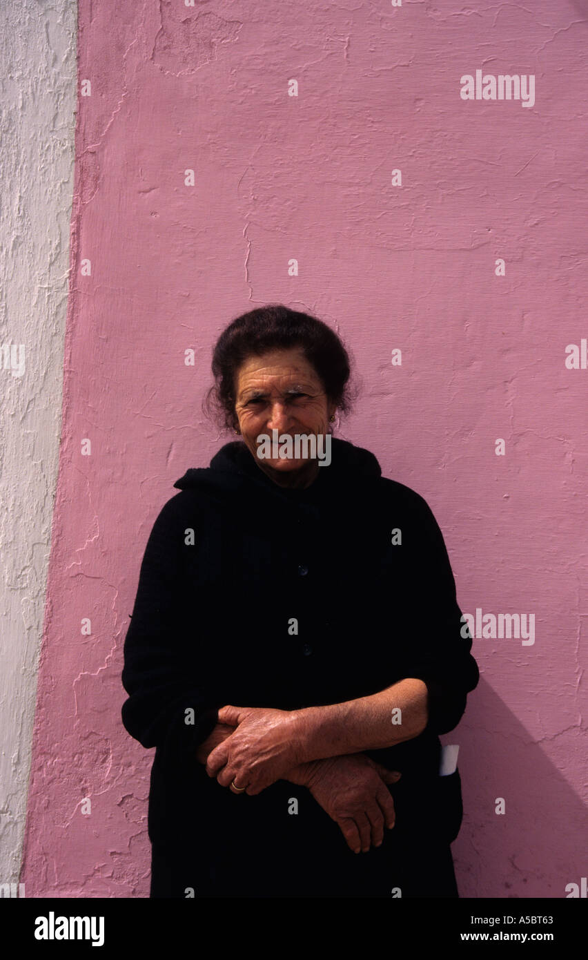 46a69fe1e6bf6 Old Italian woman outside pink trullo house in Apulia Italy - Stock Image