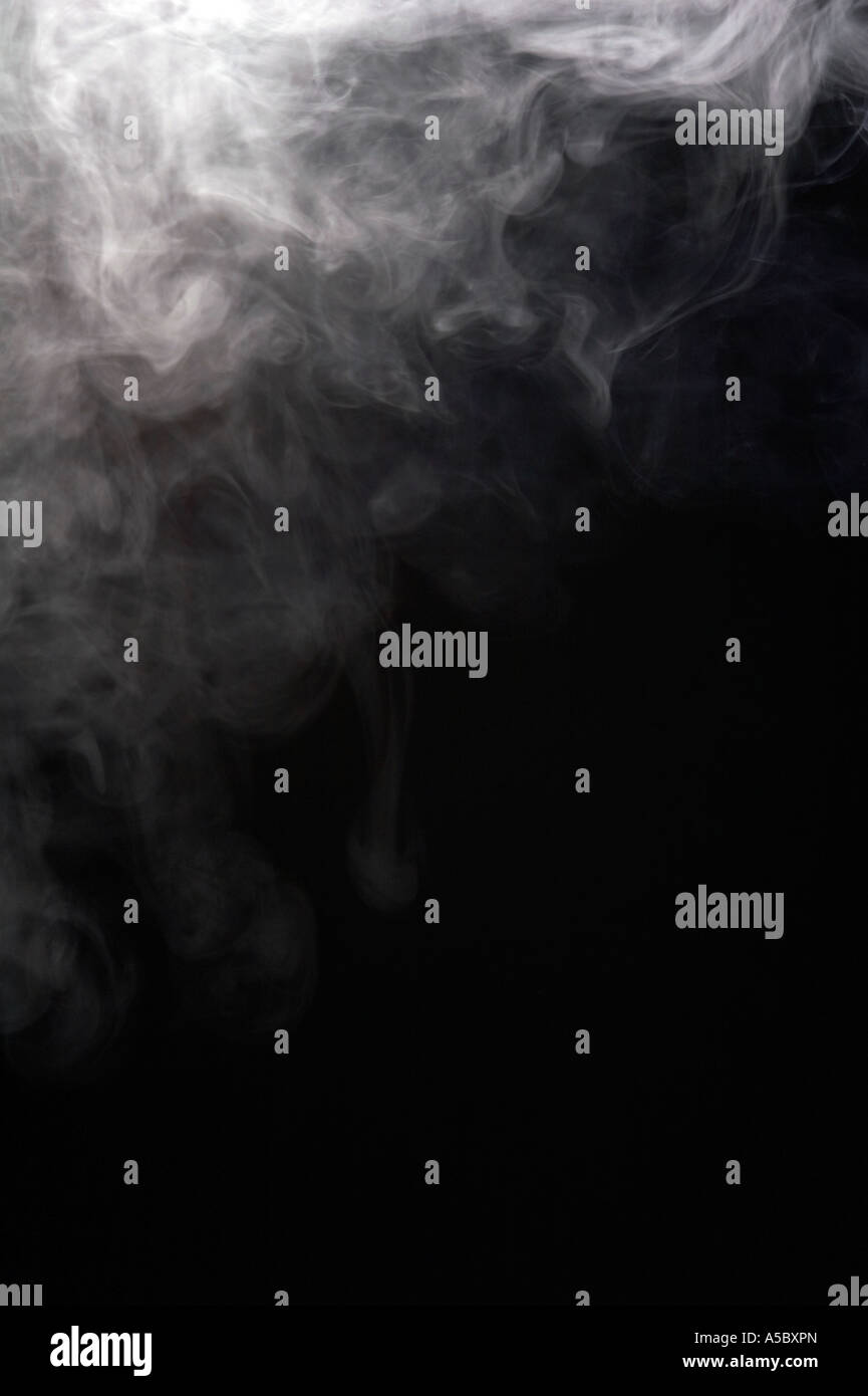 Smoke from a cigarette, black background - Stock Image