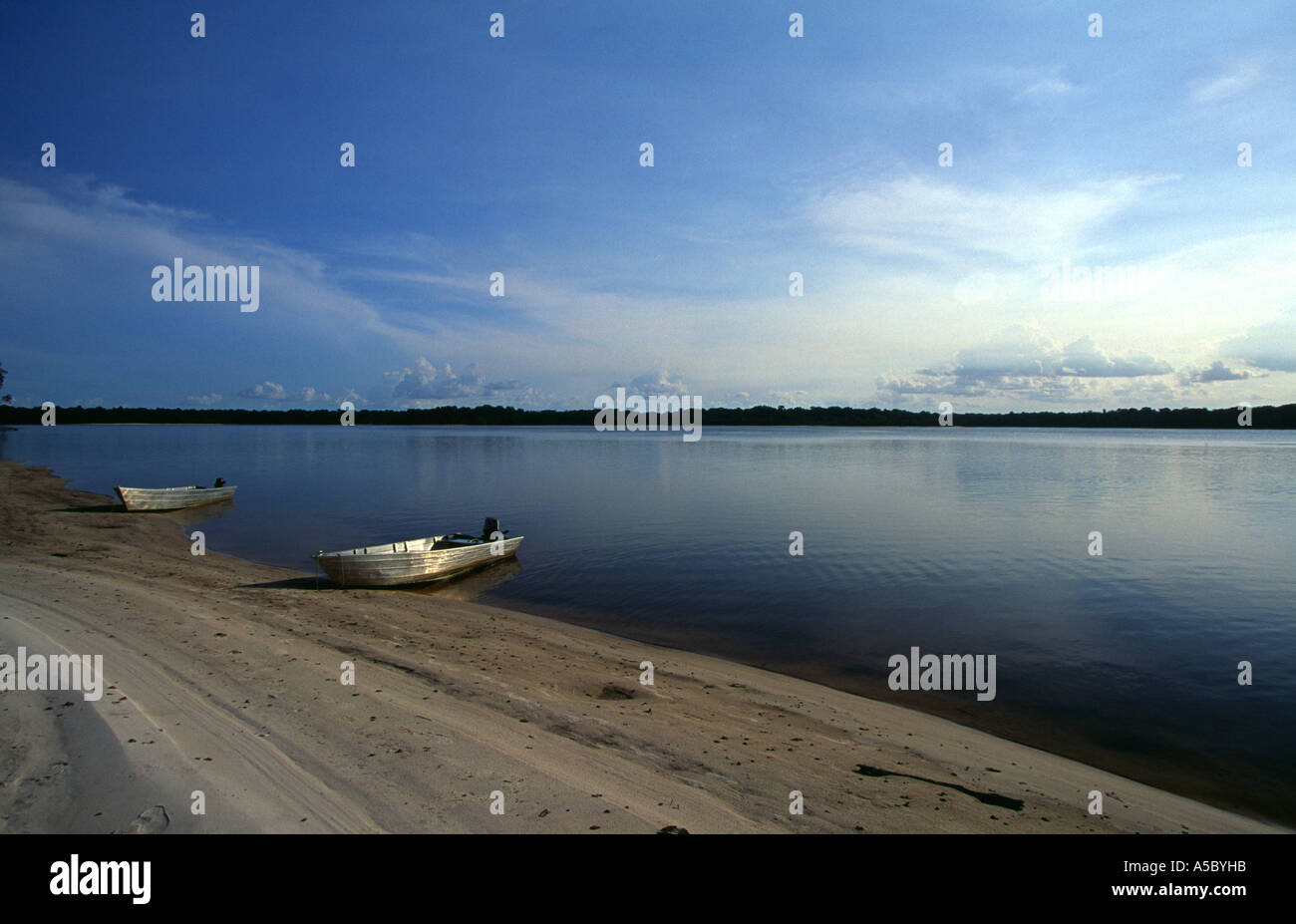 TWO BOATS MOORED ON THE RIVER BANK ON RIO NEGRO BRAZIL - Stock Image