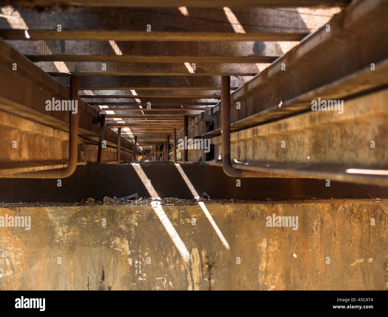Construction detail from beneath Krasae Cave trestle railway viaduct bridge Burma Railway Thailand - Stock Image