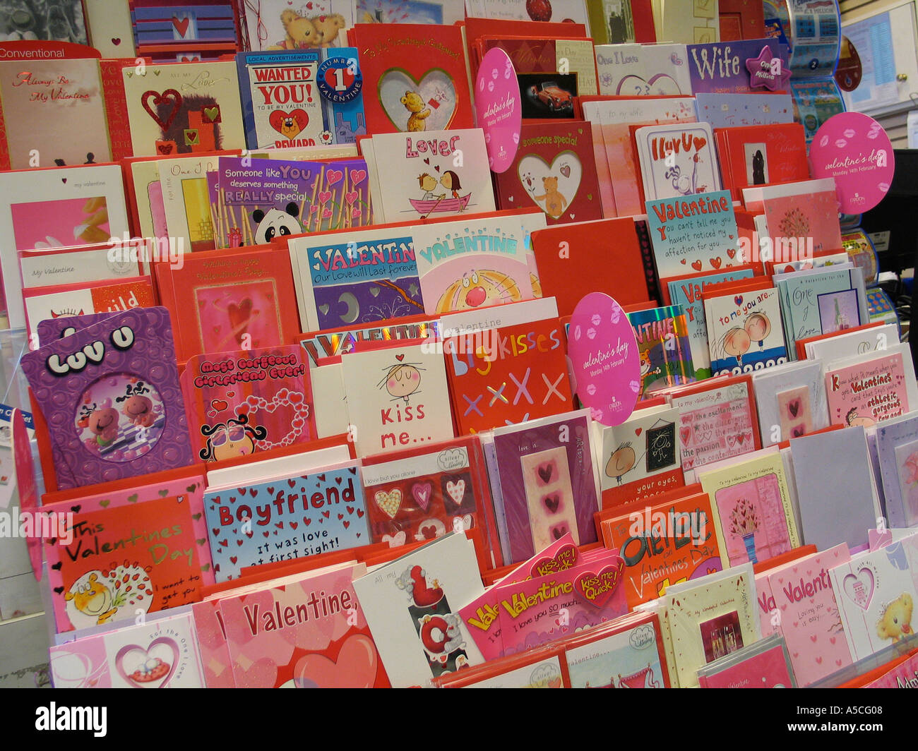 Valentines cards on display in a shop - Stock Image