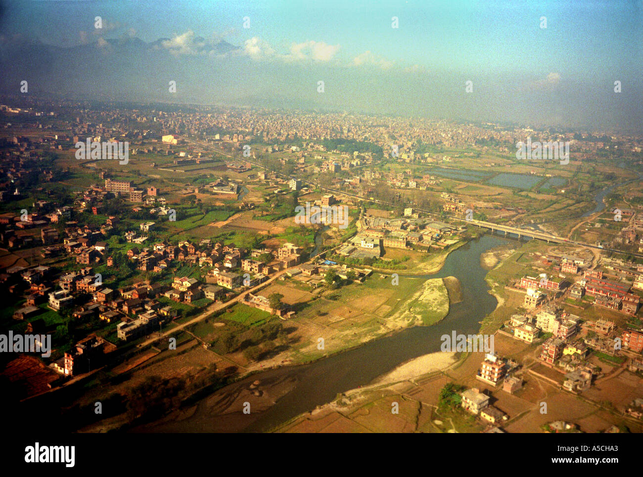 The capital of Nepal Kathmandhu seen on the approach to the airport - Stock Image