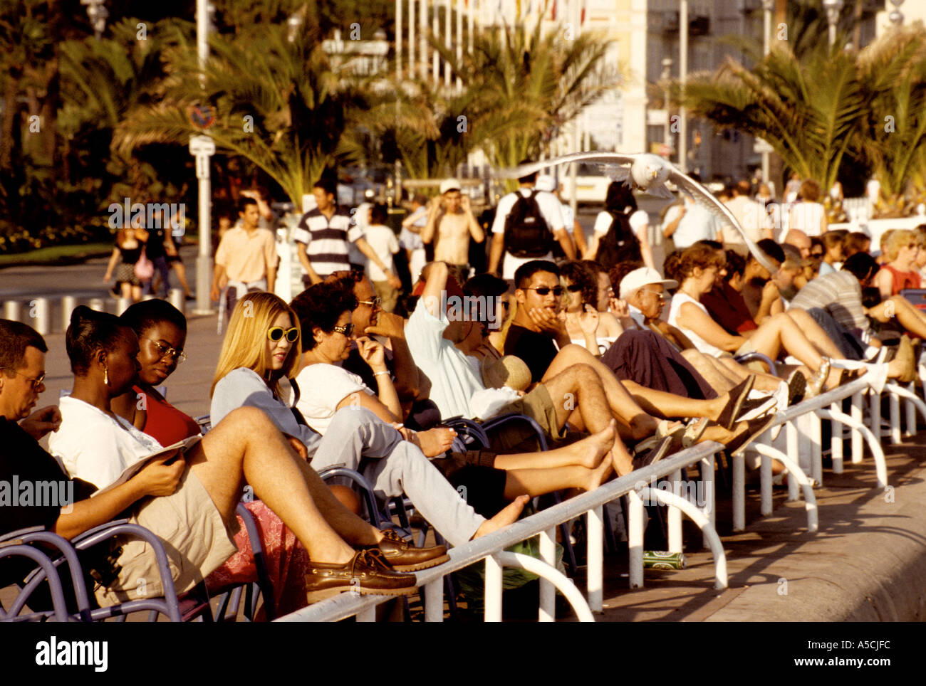 Nice France Relaxing along the waterfront promenade  - Stock Image