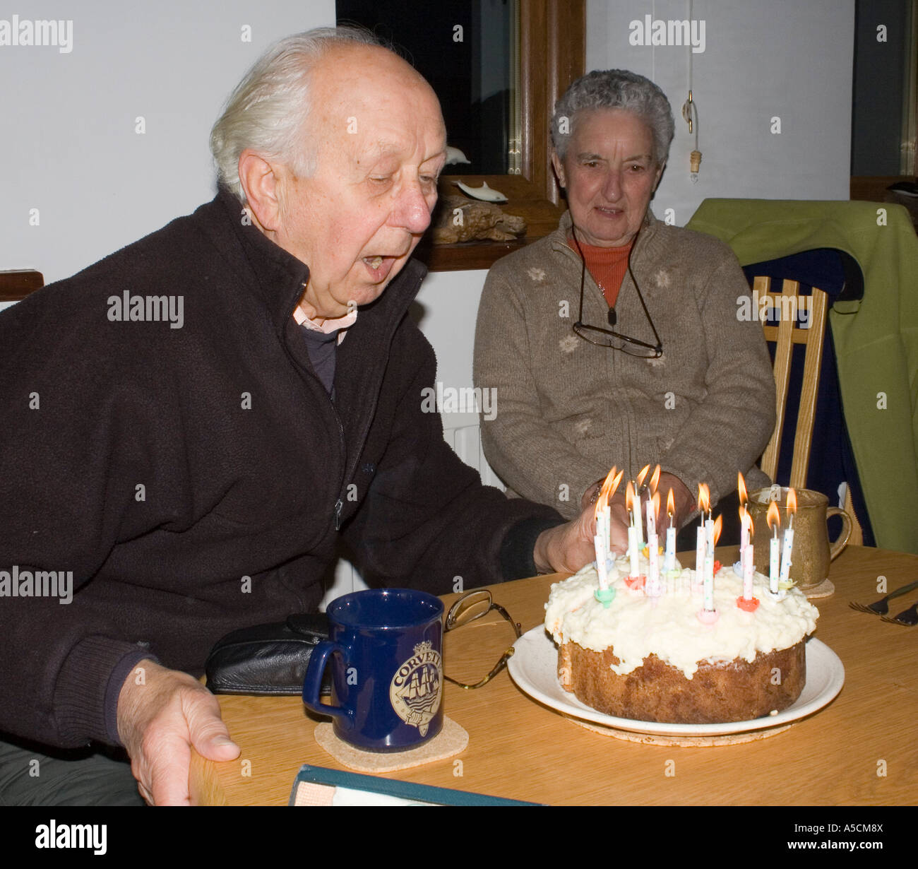 Man With Wife Blowing Out Birthday Cake Candles Wales UK