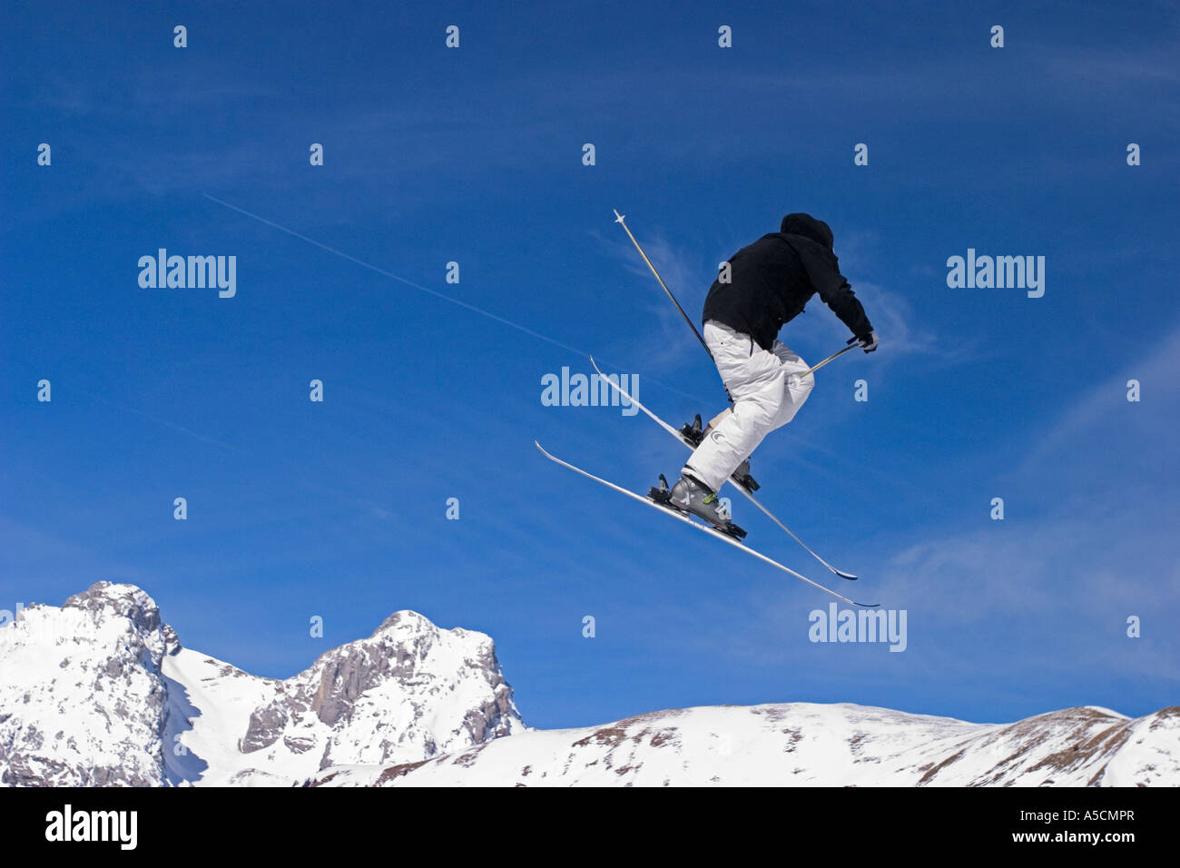 man enjoying freeride surf in winter in grand bornand alps french france station - Stock Image
