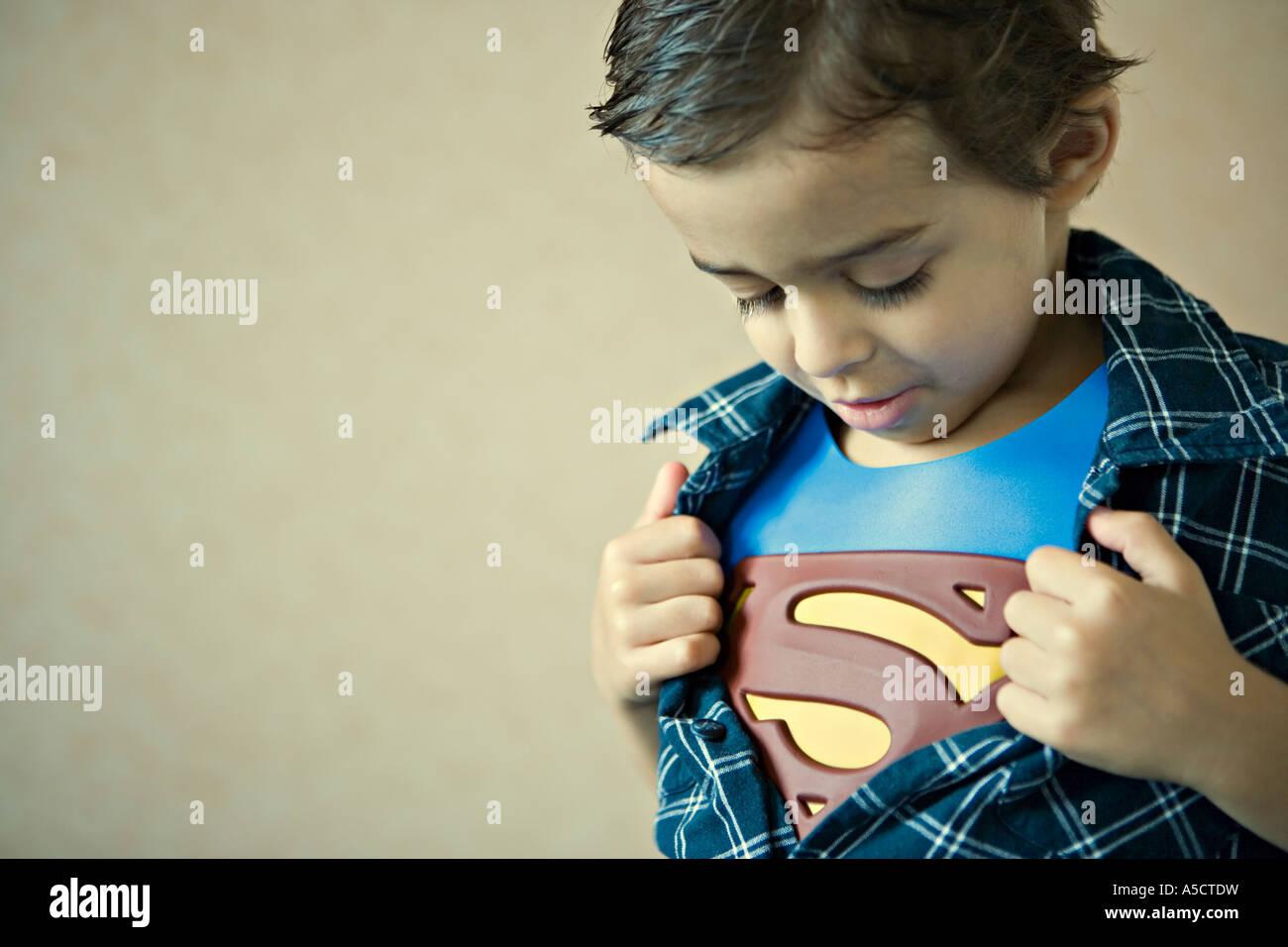 Child reveals Superman costume Stock Photo