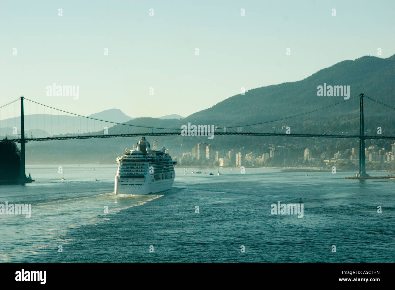 Scenic view of Royal Caribbean Cruise Lines Serenade of the Seas in the port of Vancouver BC Canada under the Lions - Stock Image