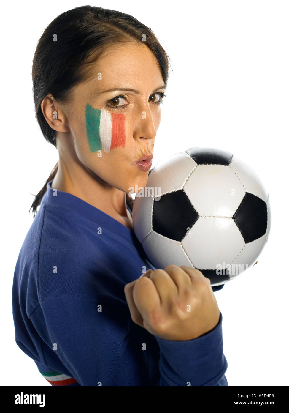 Woman with Italian flag painted on her face with football punching