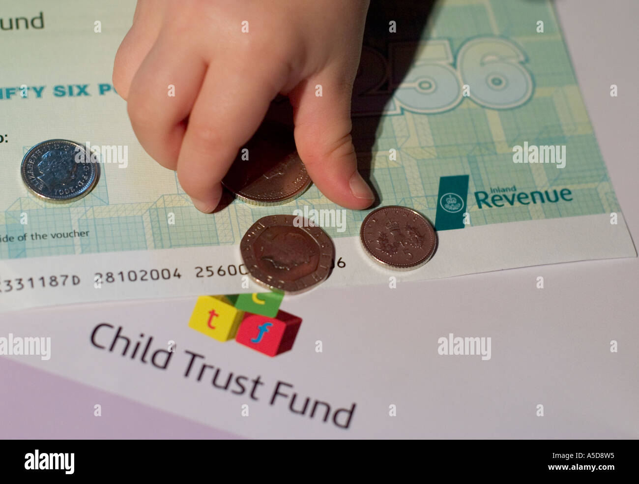 child-trust-fund-leaflet-and-voucher-with-baby-hands-picking-up-money-A5D8W5.jpg?profile=RESIZE_400x