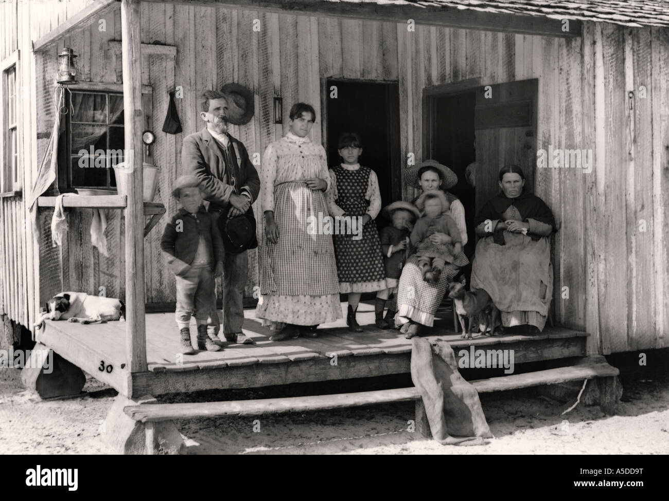 Historic photograph rural family on porch of home in Florida Stock Photo