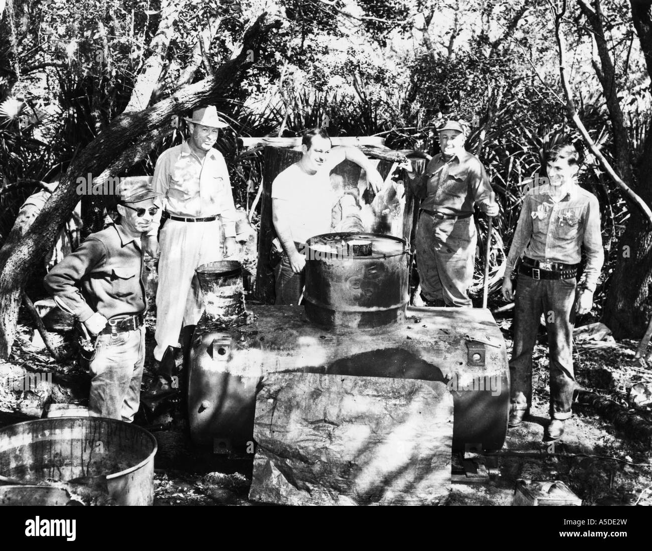 Historic photograph of Florida sheriff with seized moonshine still - Stock Image