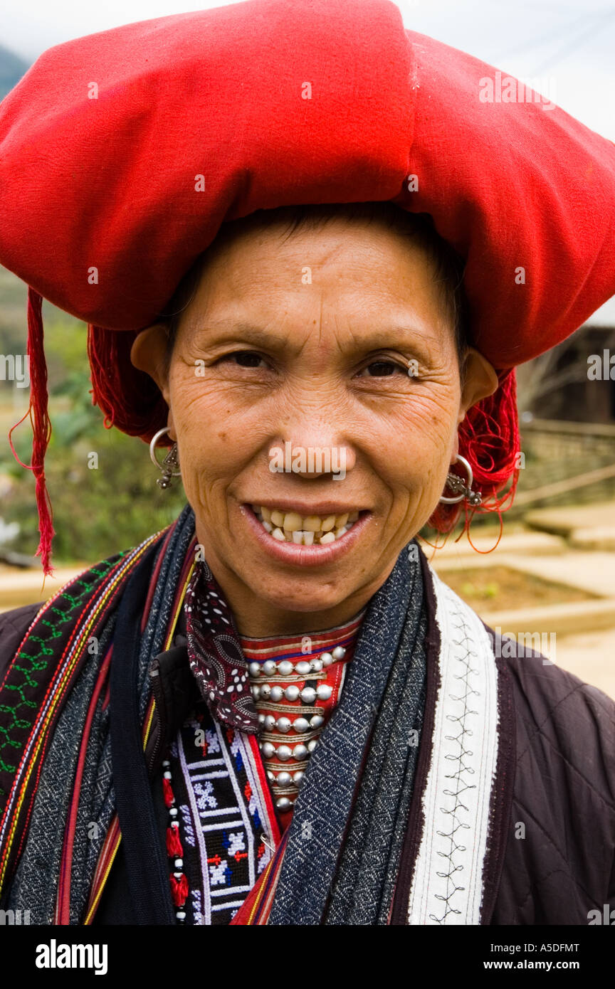 A Red Dao tribeswoman smiles in the hills of Sapa Vietnam Stock Photo
