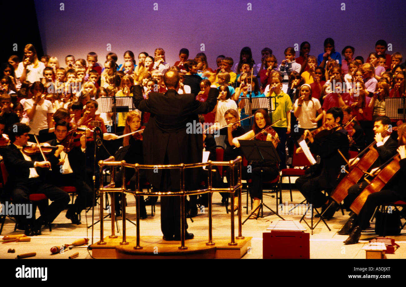 Schools Concert Choir With Accompanying Orchestra - Stock Image