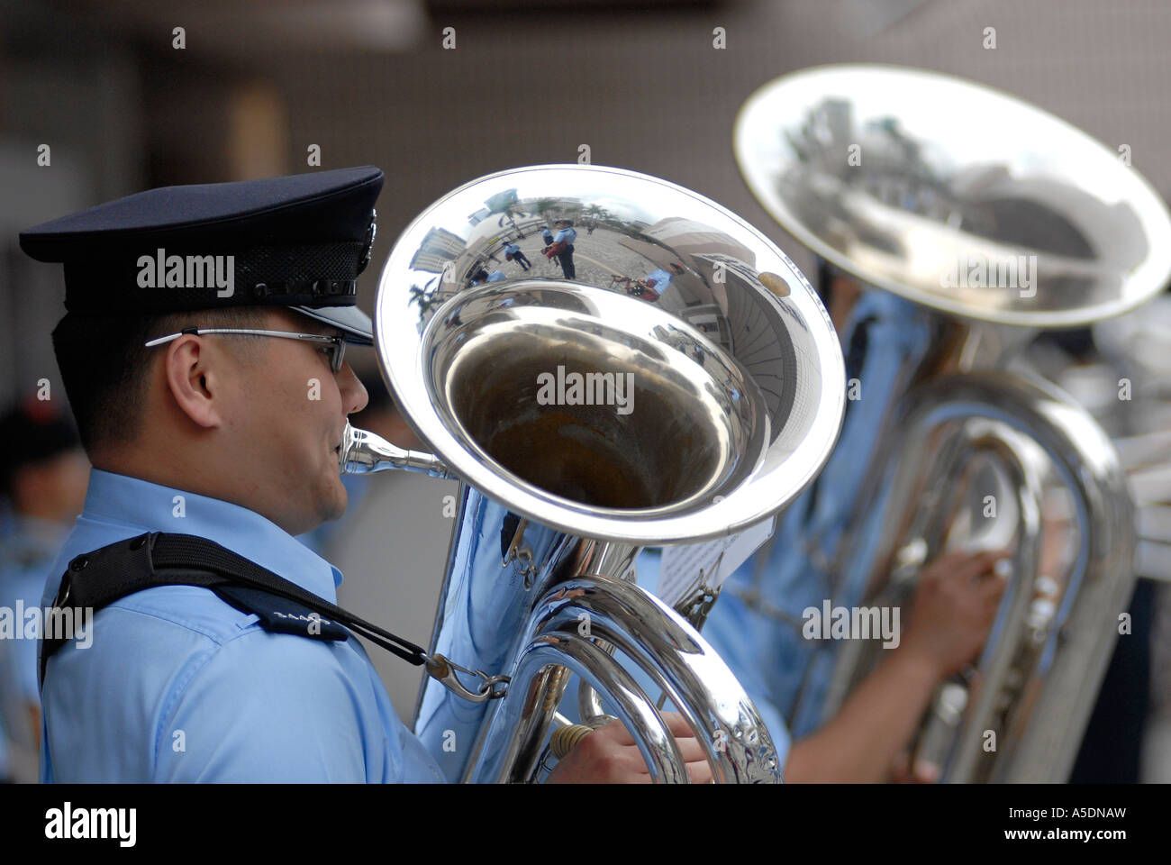 Chinese policemen in marching band uniforms playing trombones during Chinese  Lunar New Year celebrations in Kowloon c56069343