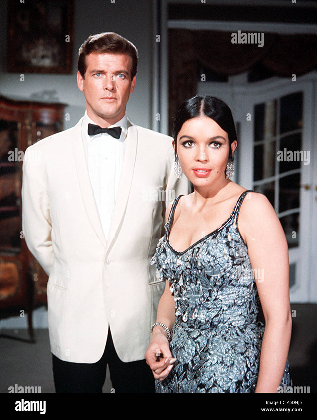THE SAINT Roger Moore as Simon Templar and Vivienne Ventura in the episode The Spanish Cow - Stock Image