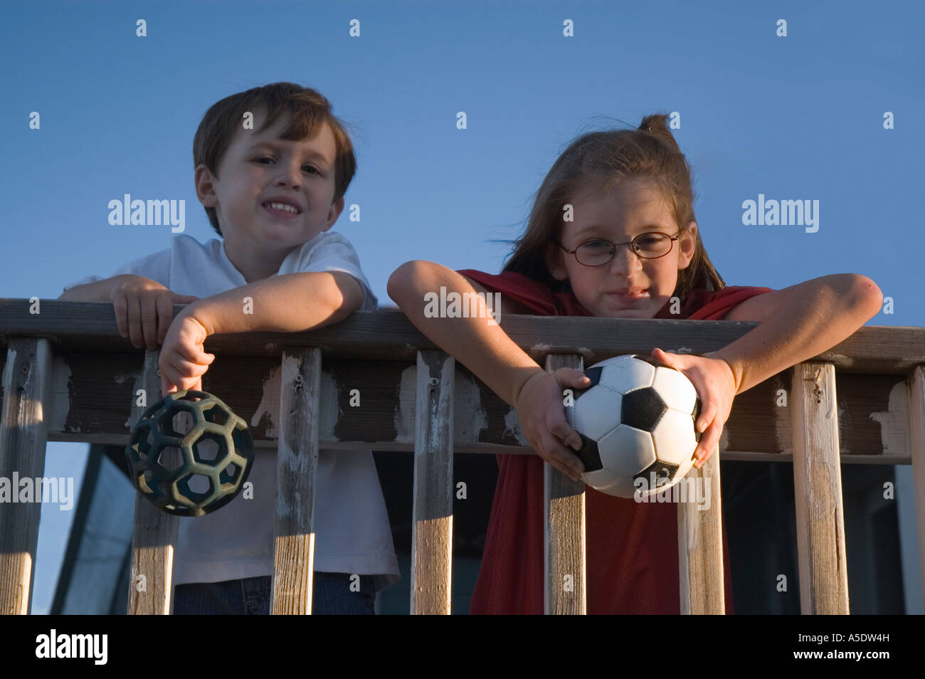 Sibling Rivalry...Let's play ball! Stock Photo