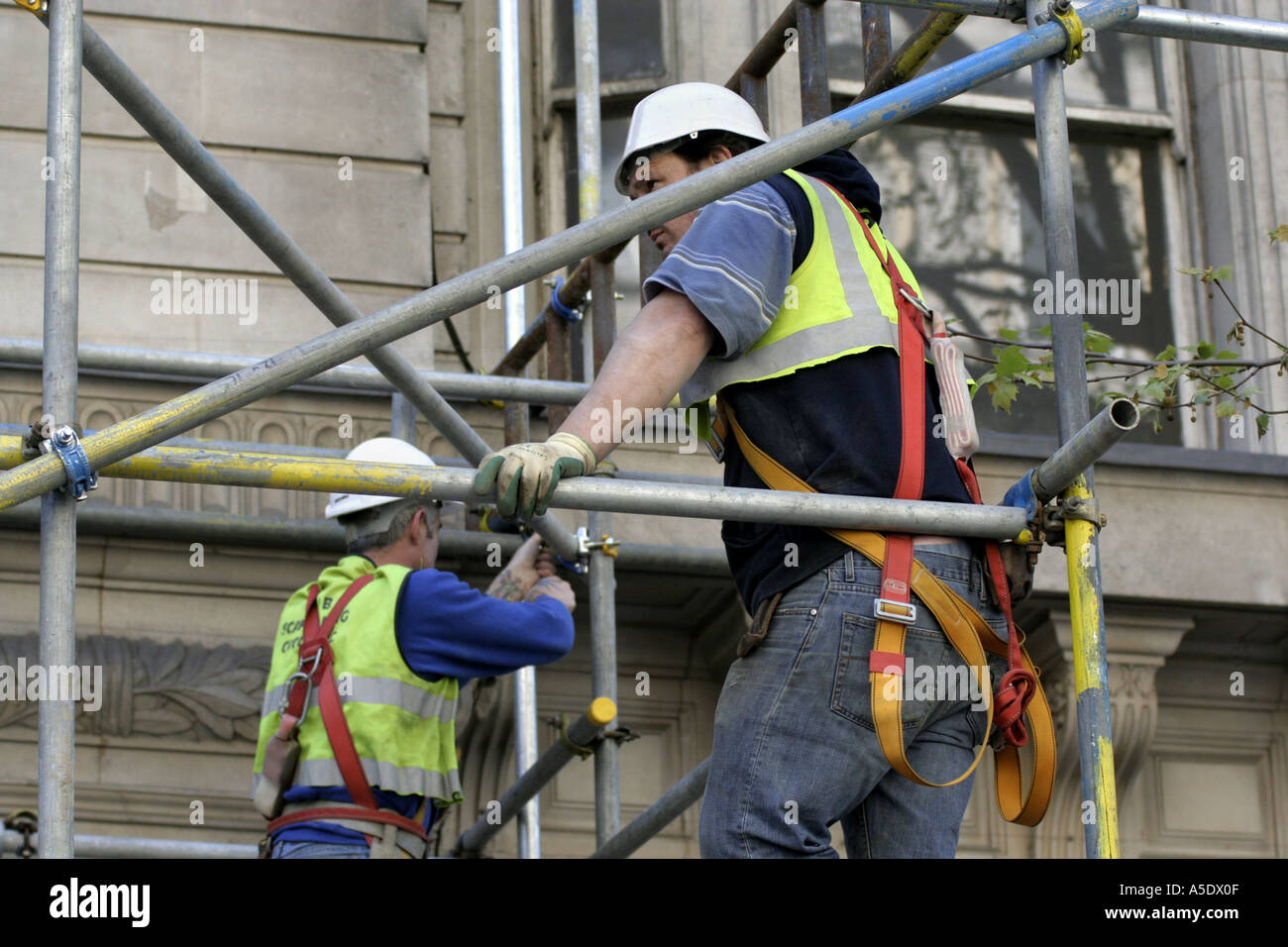 Scaffold workers in London UK - Stock Image