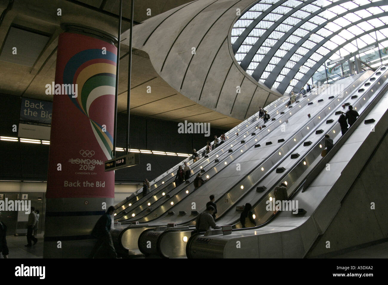 Canary Wharf tube underground station escalators in Docklands London England - Stock Image
