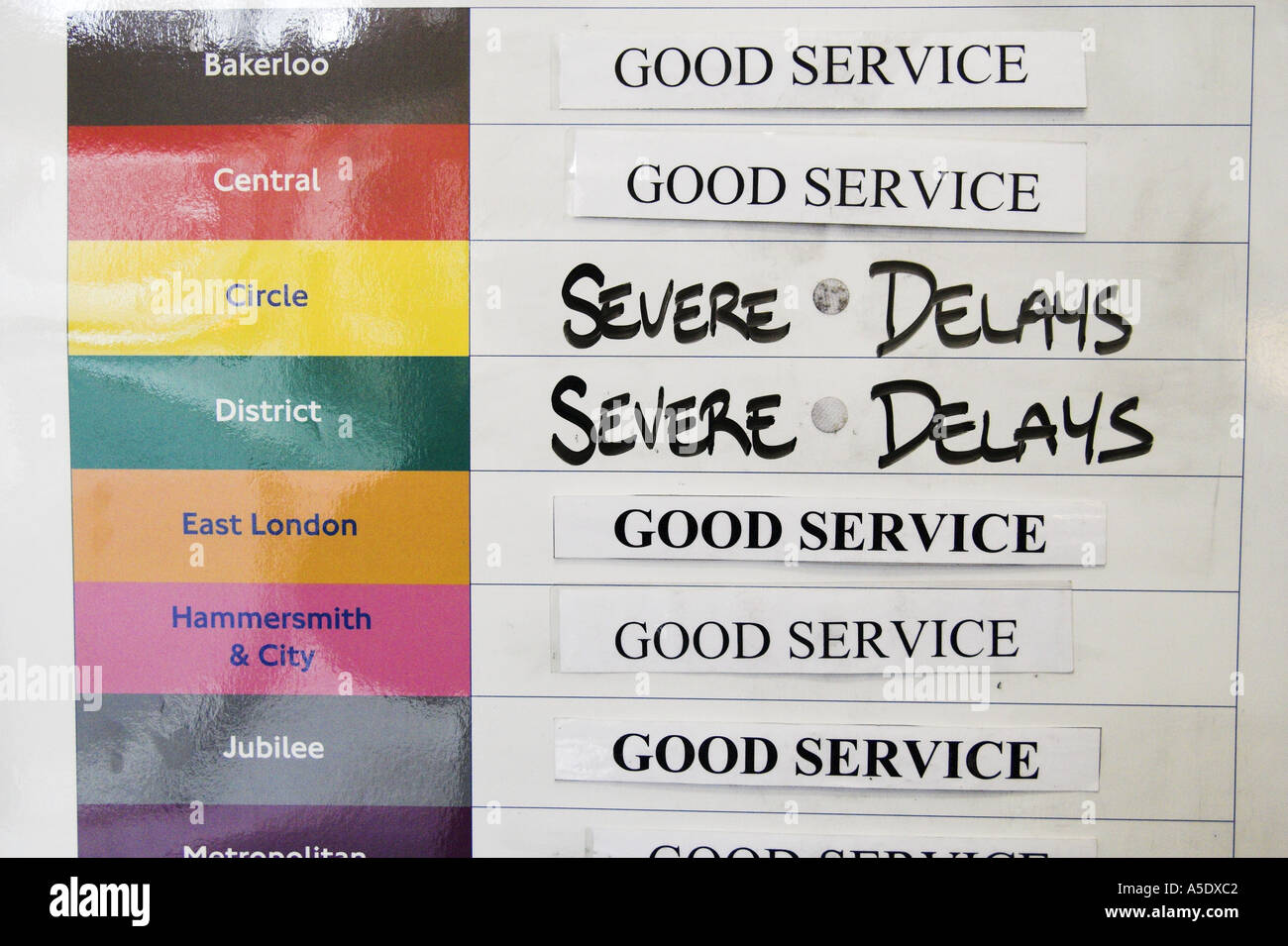 Underground Tube Subway delays noticeboard in London UK - Stock Image