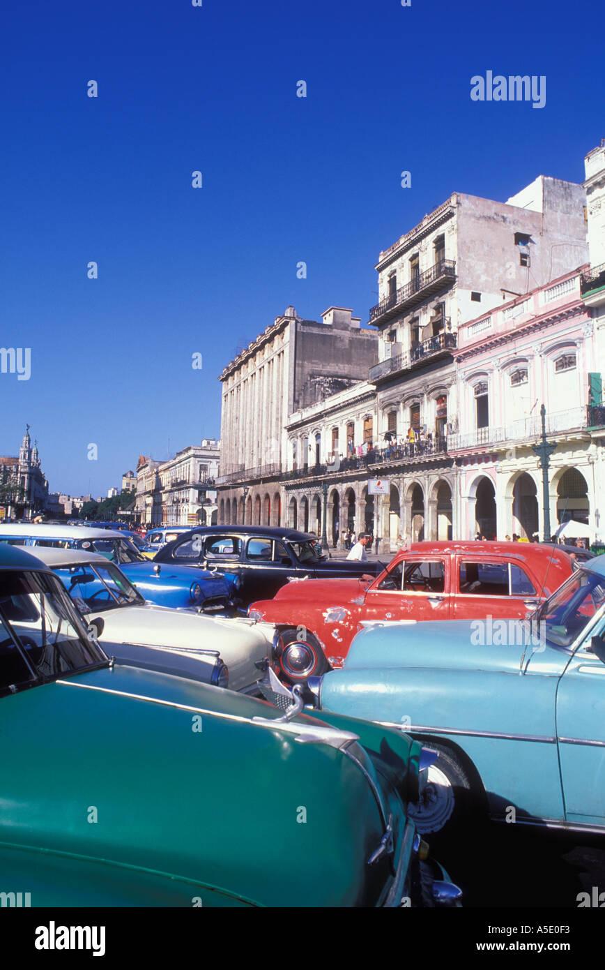1950s era automobiles and older buildings in modern day Havana Cuba ...