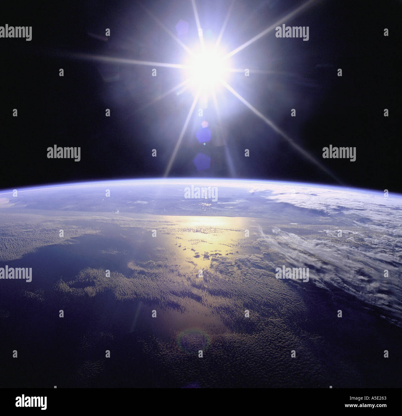 Earth from Space and Sunburst Earth from Space Stock Photo
