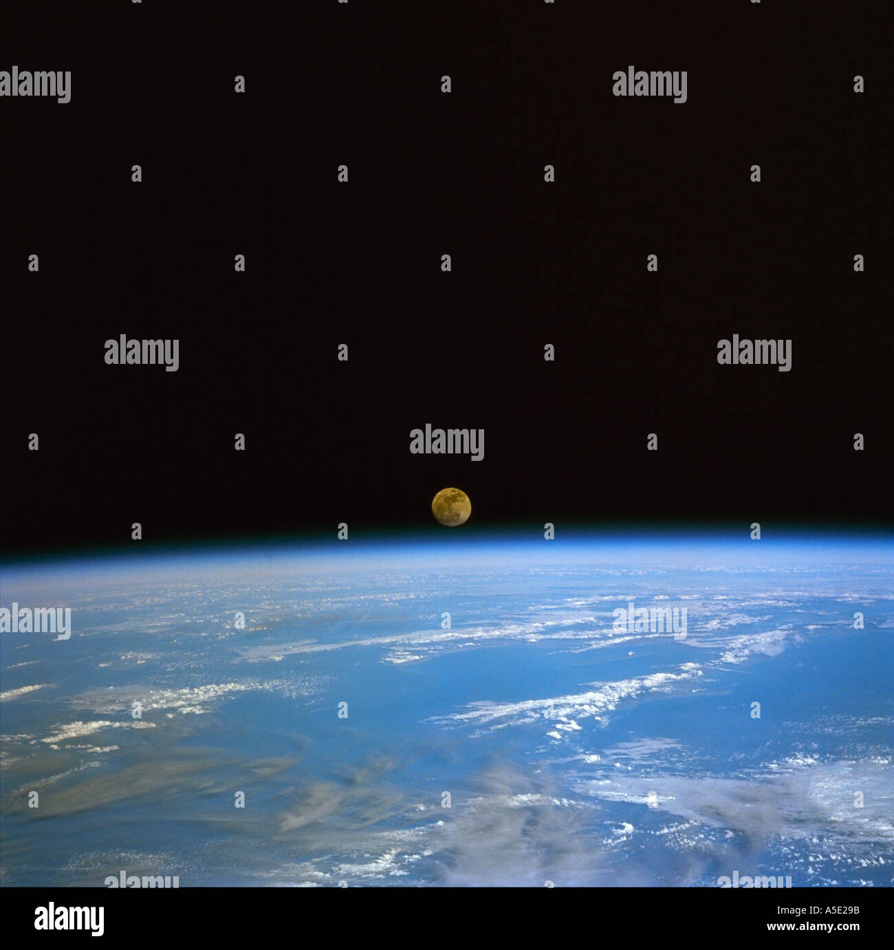 Moonrise over the Earth from Space - Stock Image