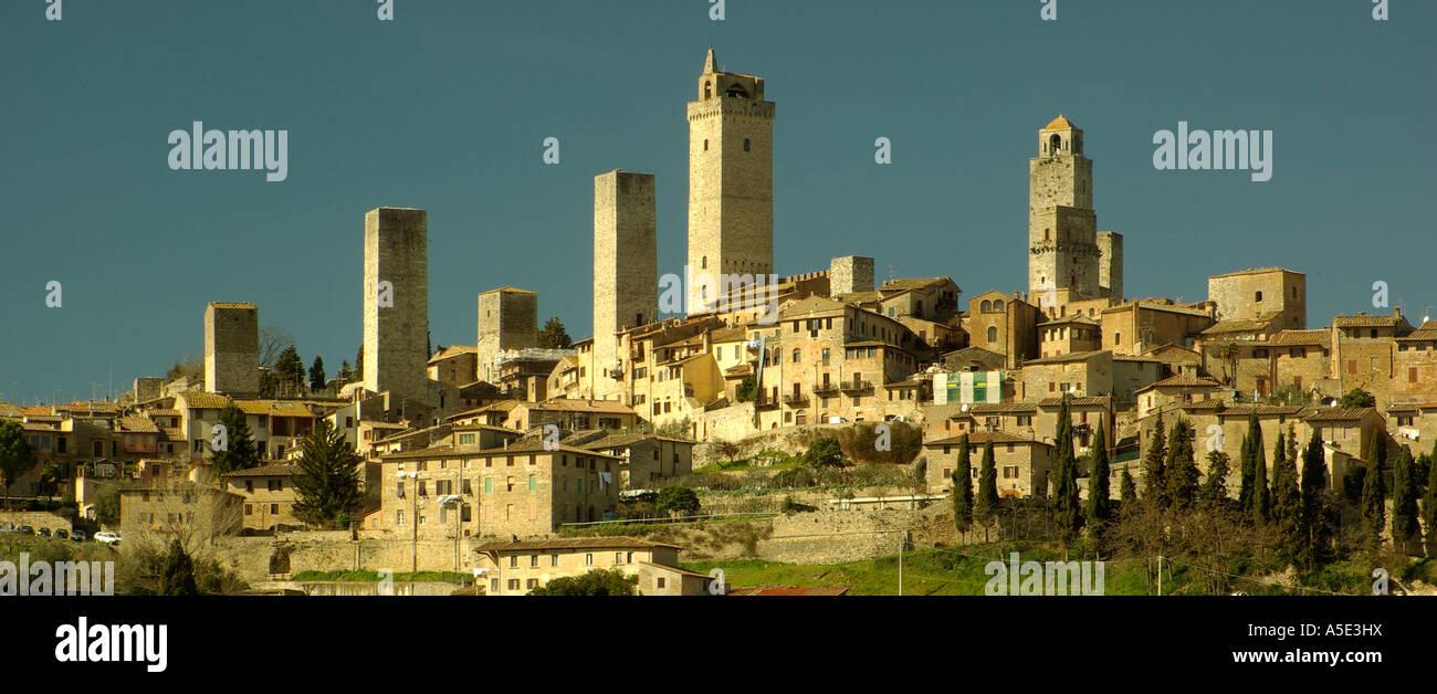 Wideshot San Gimignano hilltown with many towers Tuscany Italy horizontal blue sky - Stock Image