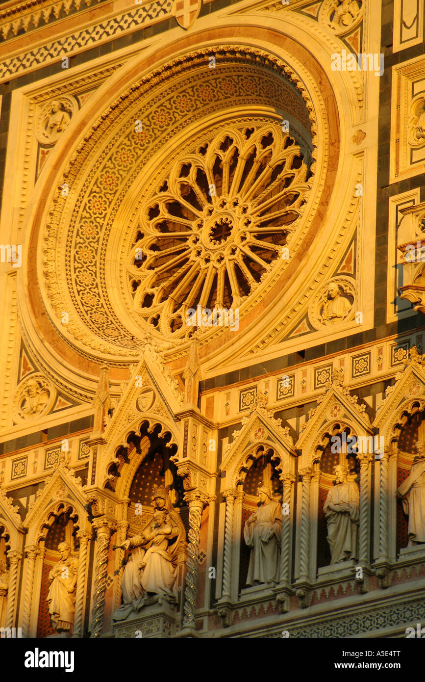 Florence Duomo Façade of Florence Cathedral rose window, Madonna and child, saints sculpted evening light Tuscany - Stock Image