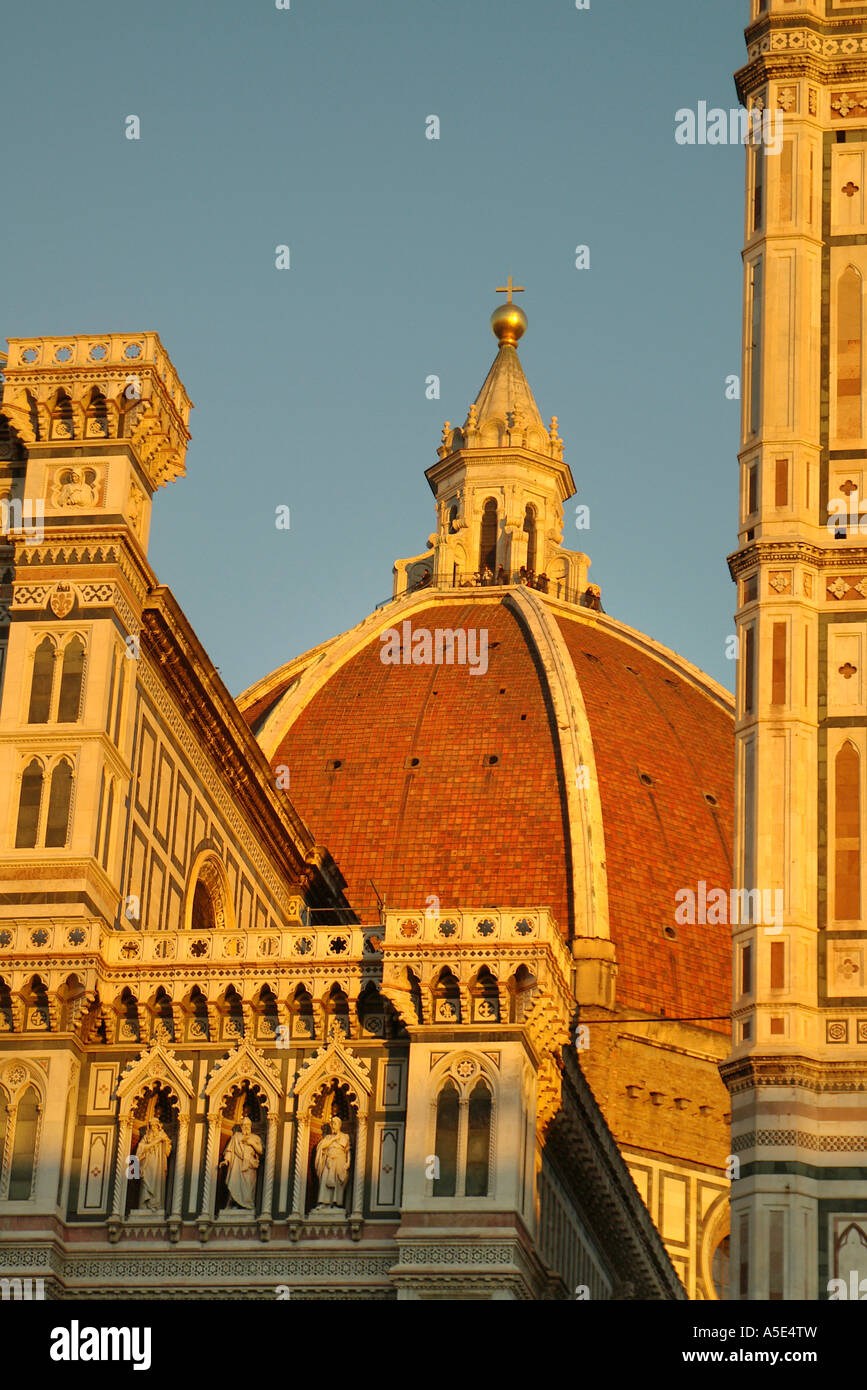 Florence Duomo  Tourists catch the last light on the marble lanterns of Florence Cathderal Tuscany - Stock Image