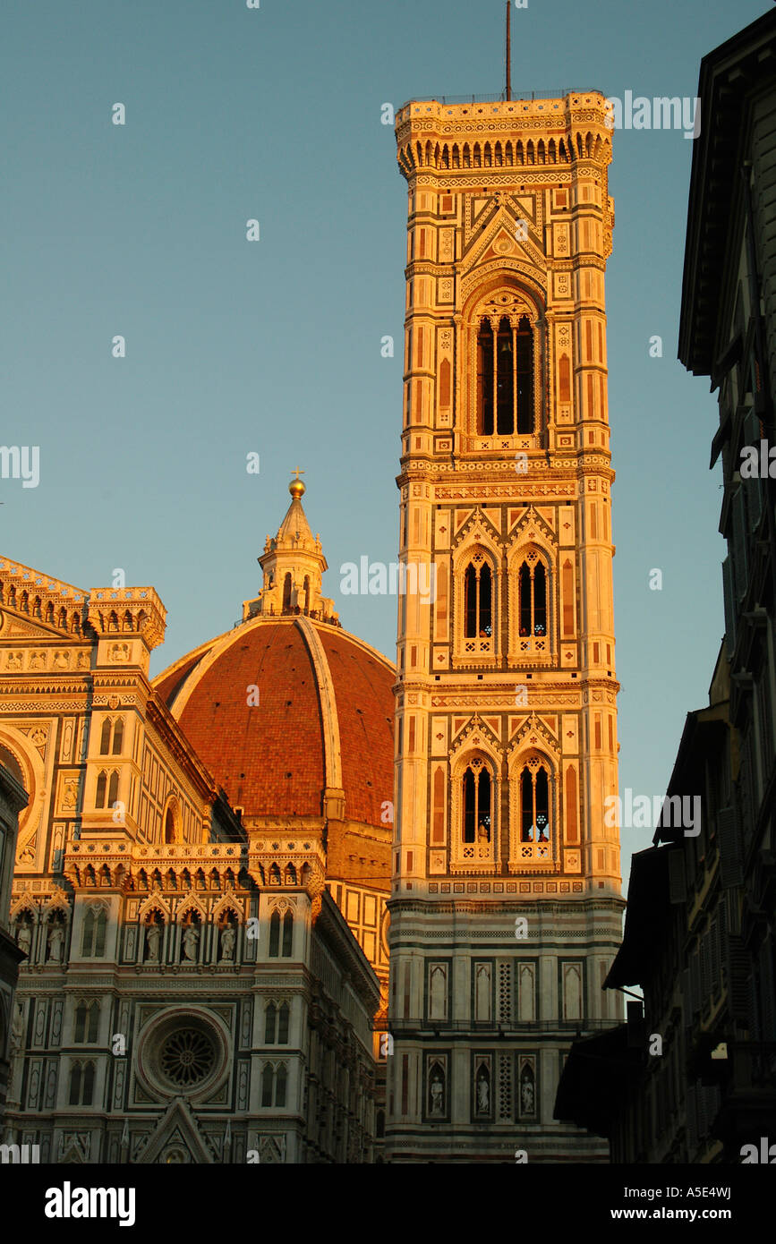 Florence Tourists look through the windows of Giotto's bell tower Florence, Italy in the evening light with - Stock Image