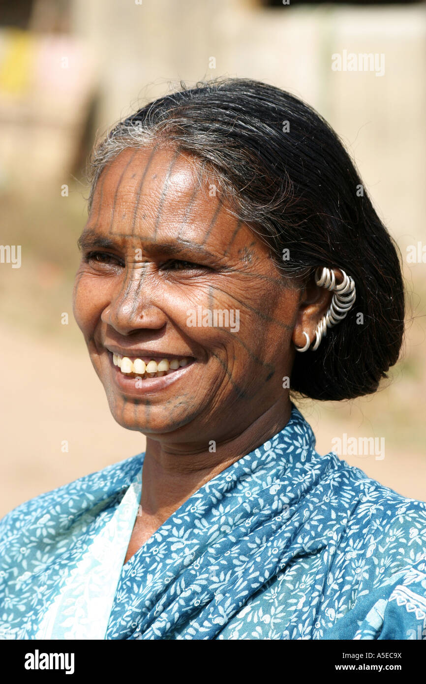 Kutia Kondh tribal woman. wearing  traditional haipins  in her hait and a tattoo on hr face,Orissa, India - Stock Image