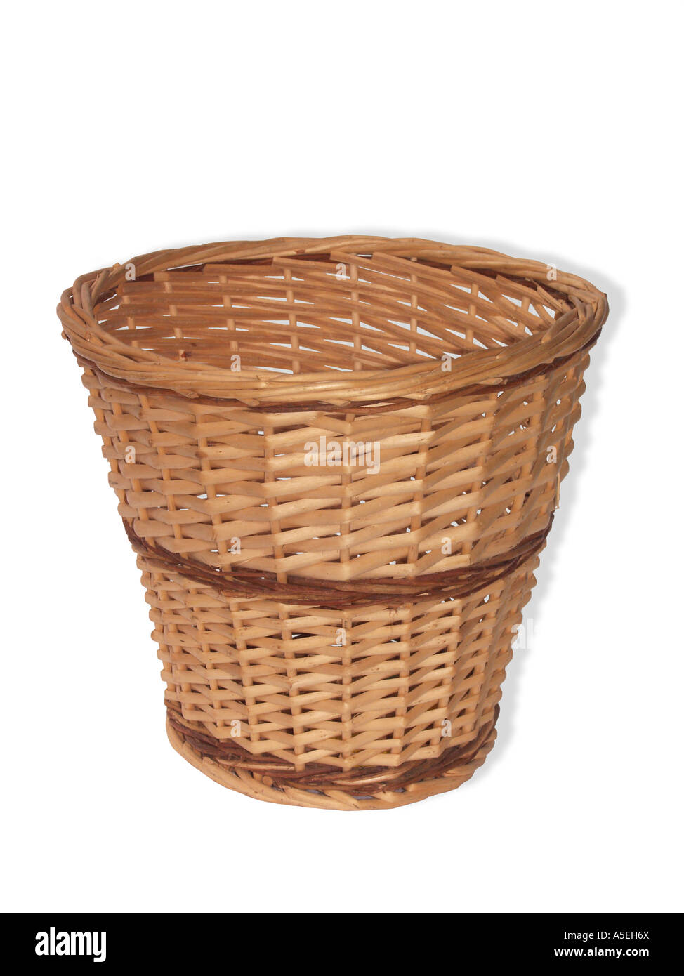Woven cane wastepaper basket on white background - Stock Image