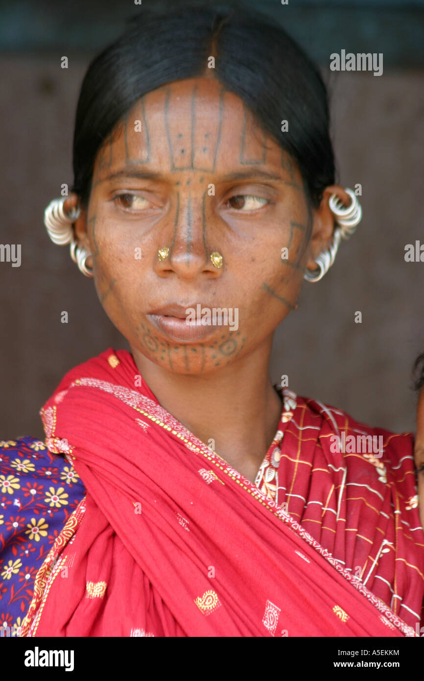traditional tatooed face and elaborate  earrings of the Kuthia Kondh tribal woman Orissa India.at weekly tribal - Stock Image