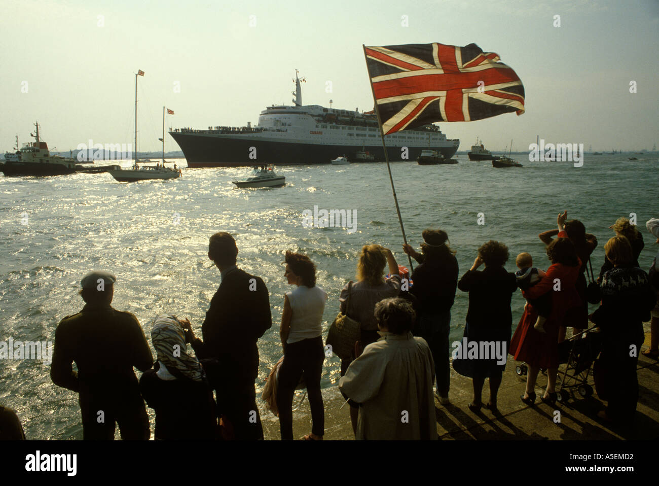 The QE11 leaves Southampton for Falklands conflict in South Atlantic Family friends gather waive goodbye 1982. HOMER SYKES - Stock Image