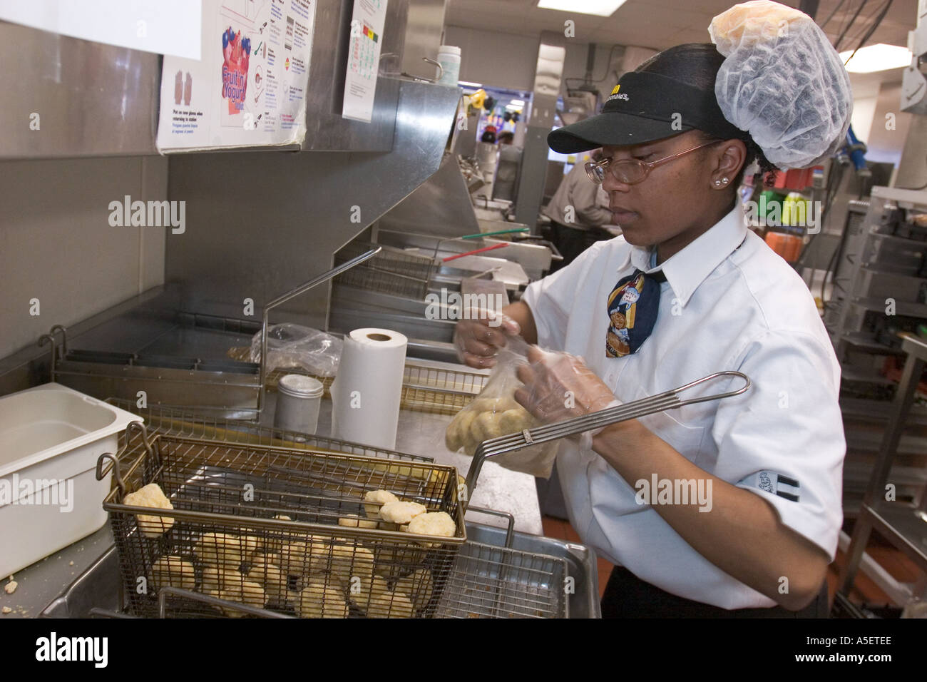 Worker at McDonalds Restaurant - Stock Image