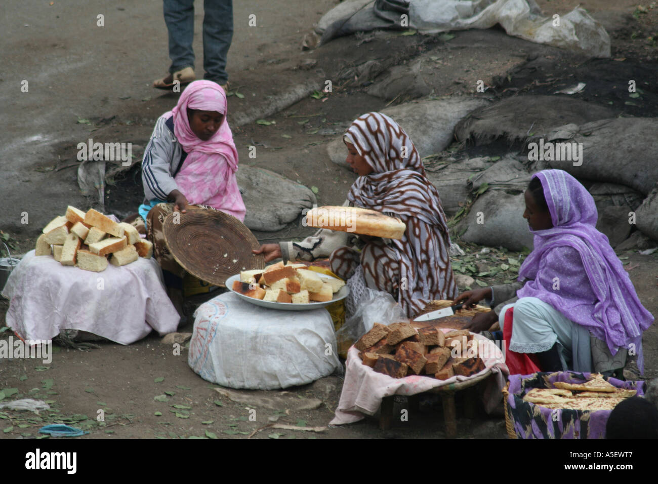 Harar, Ethiopia, women selling bread and cakes in the market Stock Photo