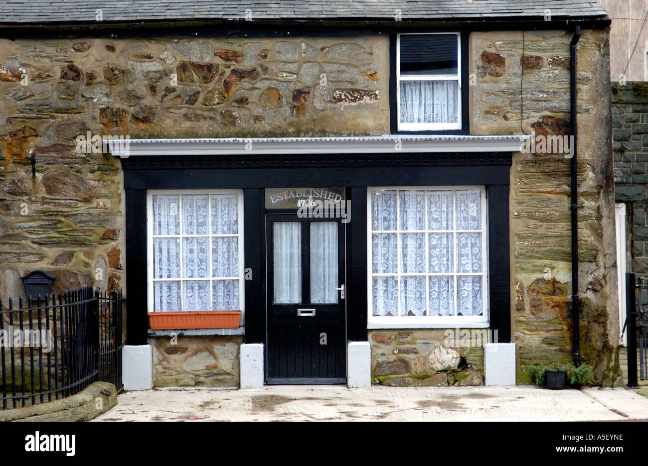 Former local shop established 1726 now converted to house in the Welsh language speaking village Llan Ffestiniog North Wales UK - Stock Image