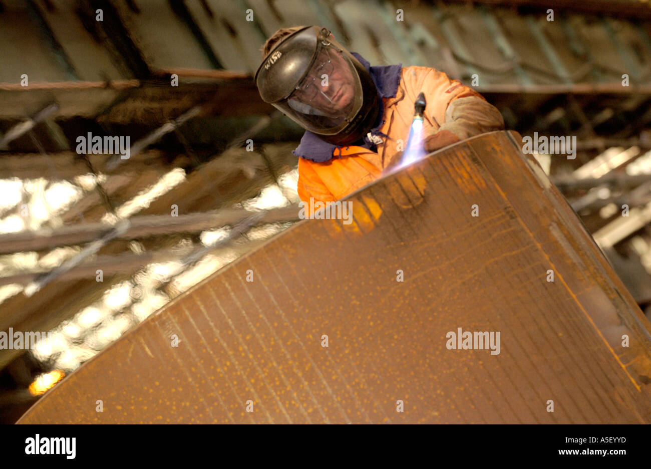 Engineers fabricate part of a steel foot and cycle bridge to cross the River Usk at Newport Gwent South Wales UK - Stock Image