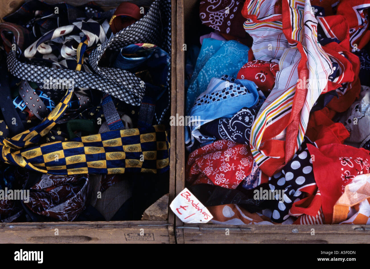 Ties and bandanas at a jumble sale in London - Stock Image