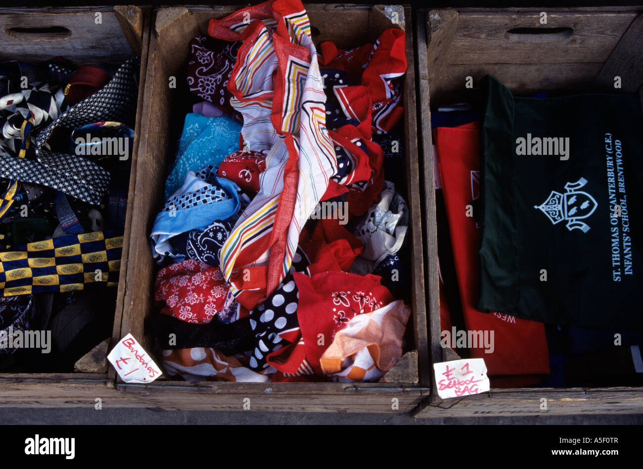 Ties bandanas and school bags for sale at a London street stall - Stock Image