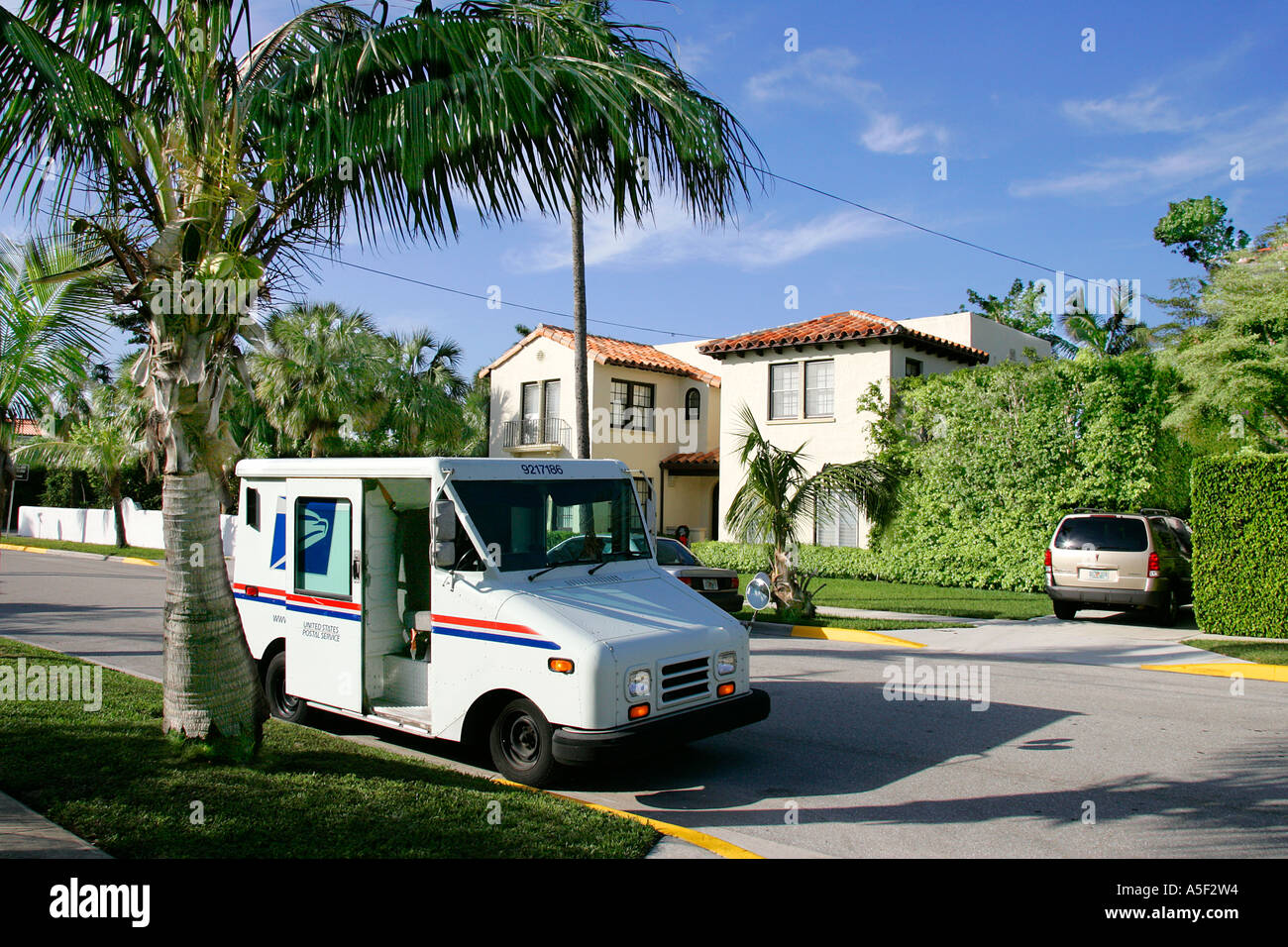 US mail service delivering car vehicle transport Mailbox letterbox postbox postal correspondence shipping delivery red flag - Stock Image