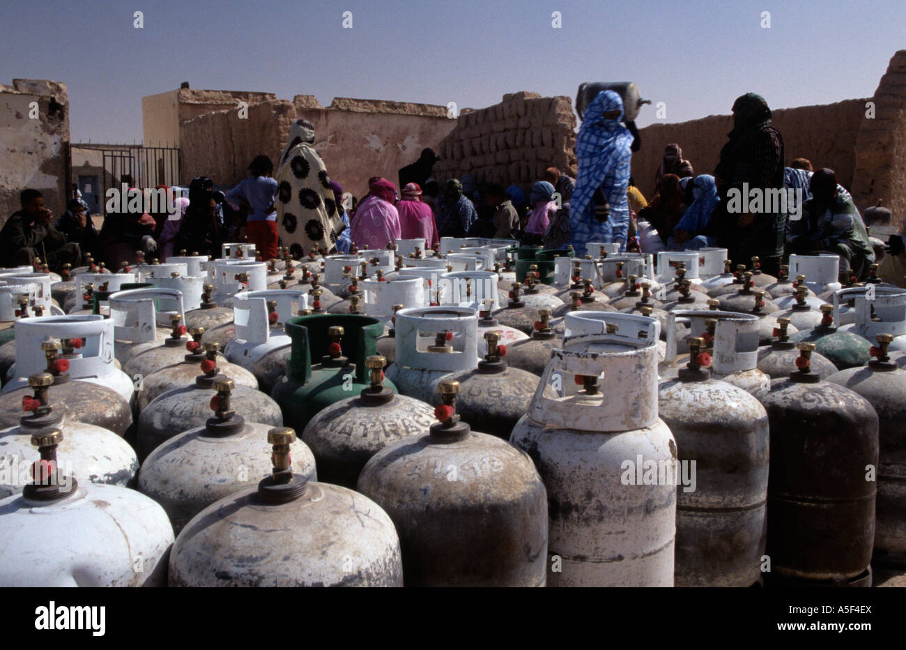 People from the Saharawi refugee camp in Tindouf Western Algeria collecting gas bottles - Stock Image