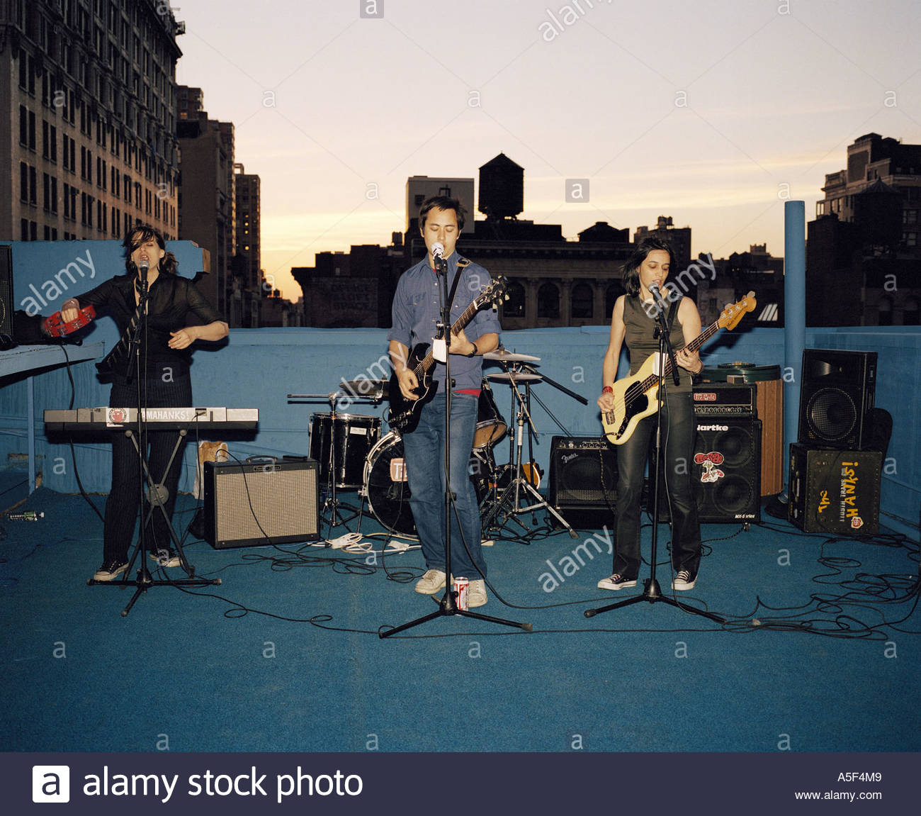 Rock band playing on the roof New York - Stock Image
