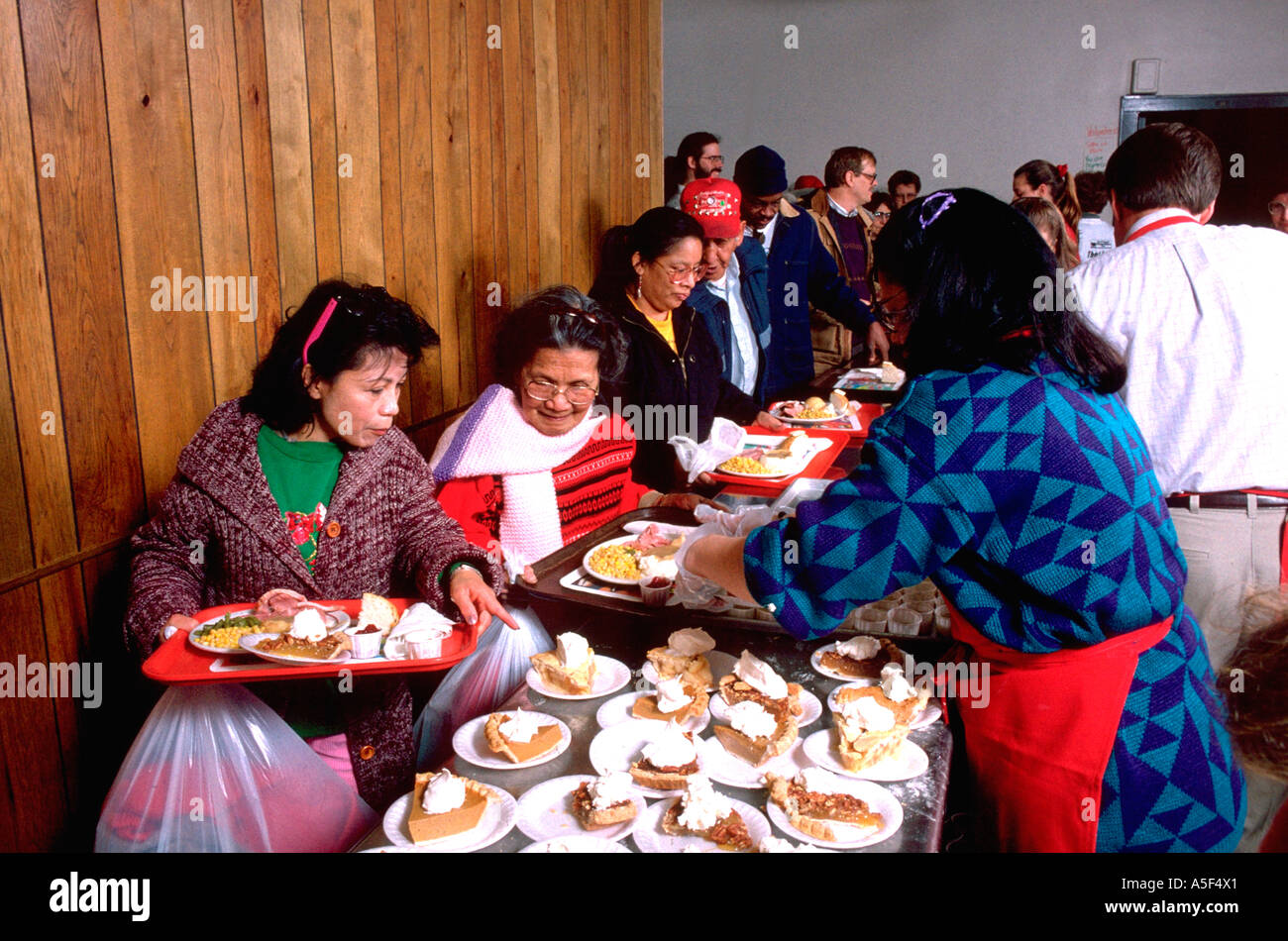 Hmong family being served Christmas dinner at church soup kitchen