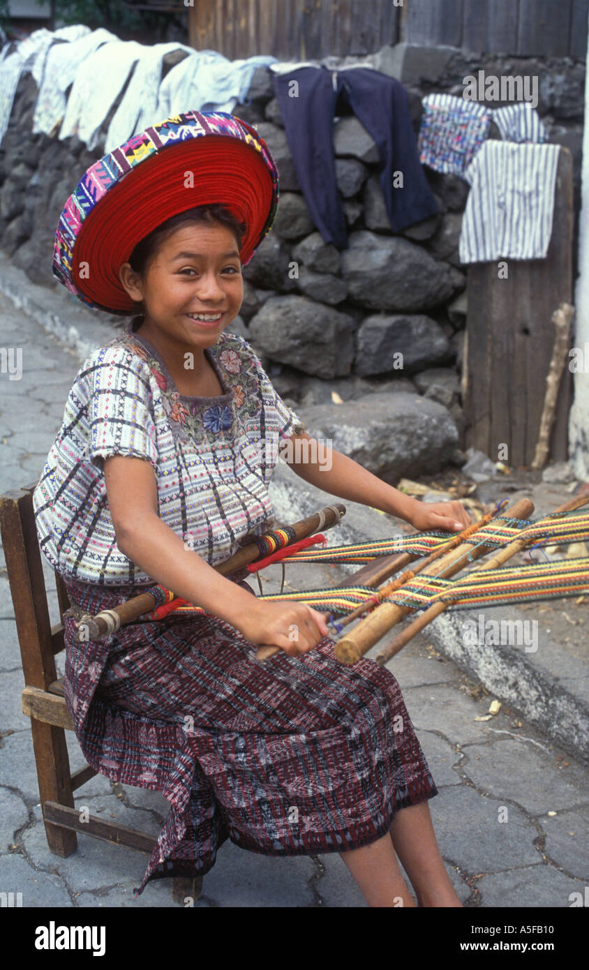 Young Mayan Quiche woman at a loom weaving cloth in the village of Santiago Atitlan Guatemala - Stock Image