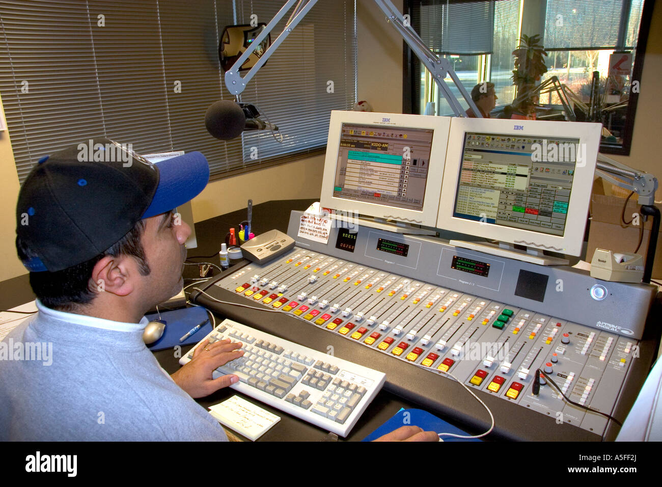 Sound engineer operating commercial broadcast radio control