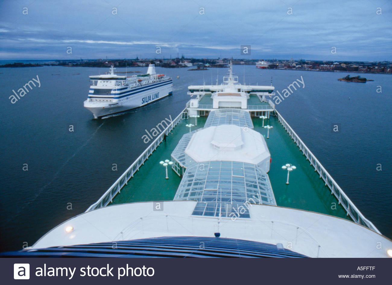 Ferryboats entering leaving the port of Helsinki Finland - Stock Image