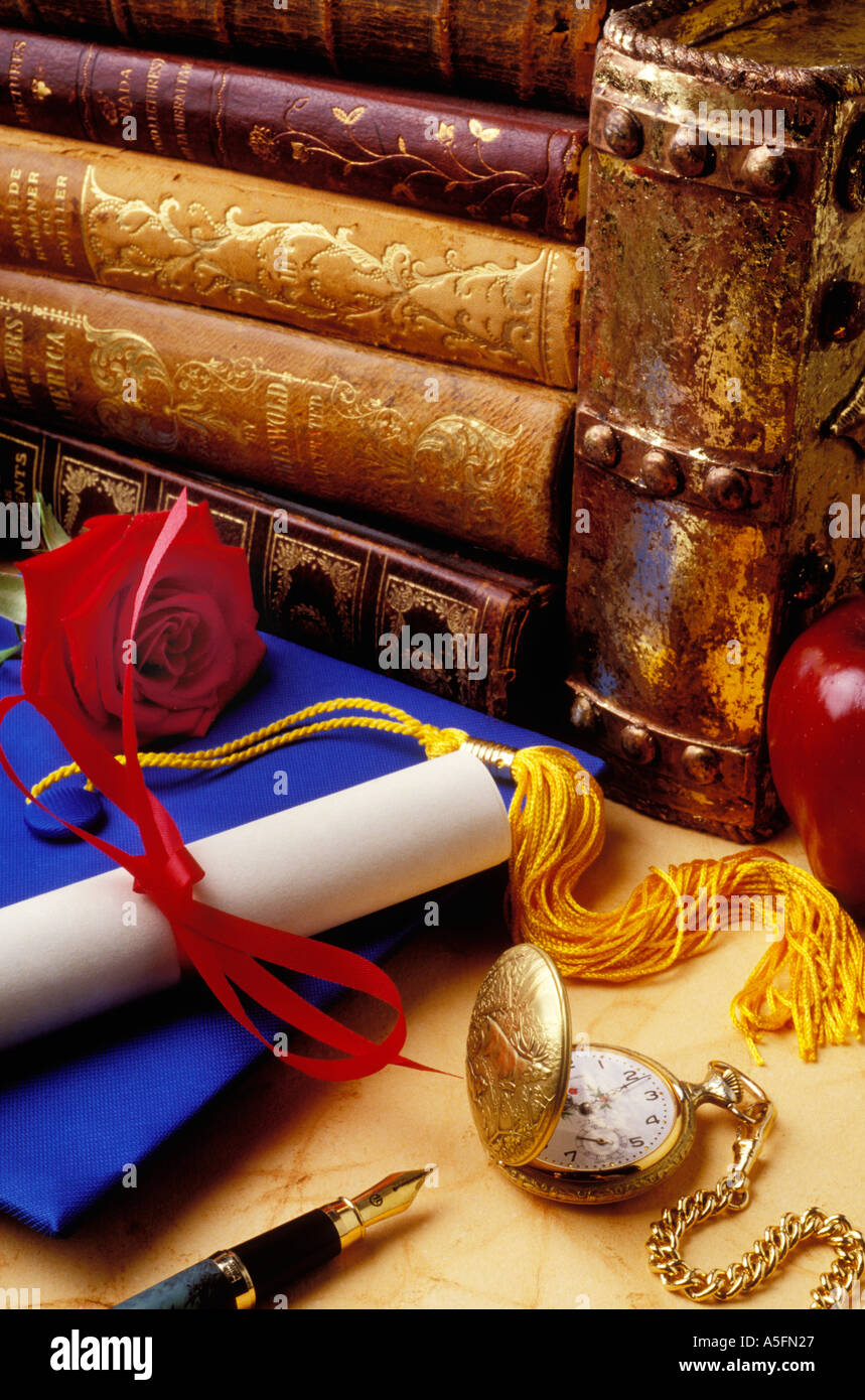 Graduation cap with diploma red rose old books pocket watch and fountain pen - Stock Image
