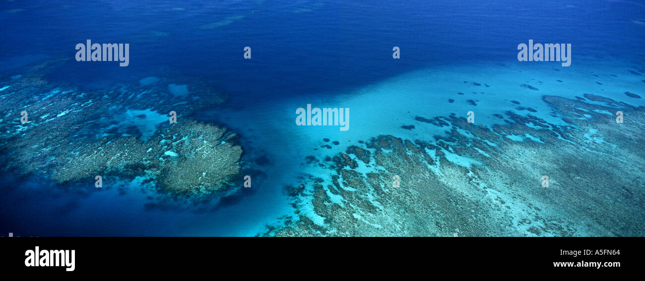 A panoramic aerial photograph of the clear blue waters of the Great Barrier Reef Australia credit JR MarshallStock Photo